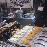 A delicious Taiyaki, fish shaped pancake shop creating long queue in Sapporo