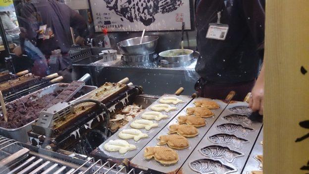 A delicious Taiyaki, fish shaped pancake shop creating long queue in Sapporo